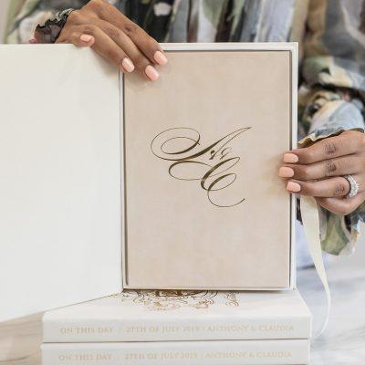 Wedding initials monogram in gold foil on suede invitation
