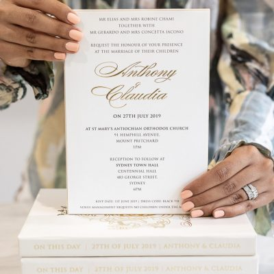 Elegant wedding invitation in luxury box embossed with gold foil