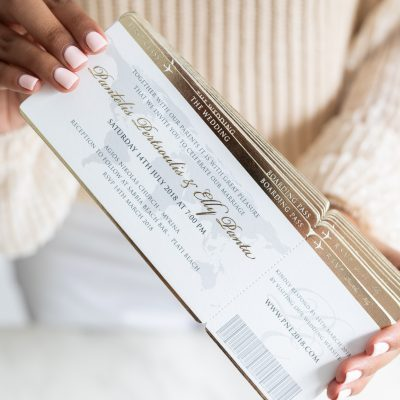 Boarding pass wedding invitation for luxury wedding destination