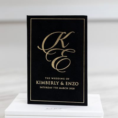 Black and gold wedding invitation with black suede and gold foil
