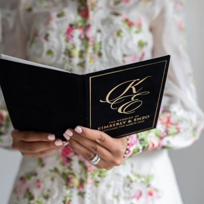 Elegant book wedding invitation with black suede and gold foil