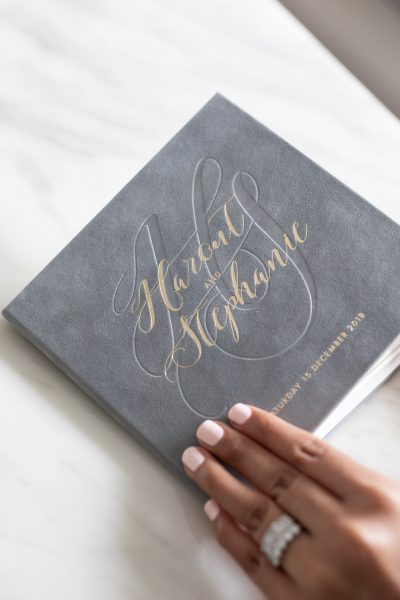 Grey and gold modern wedding invitation hardcover with grey suede