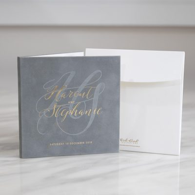 Grey and gold modern wedding invitation hardcover booklet with grey suede