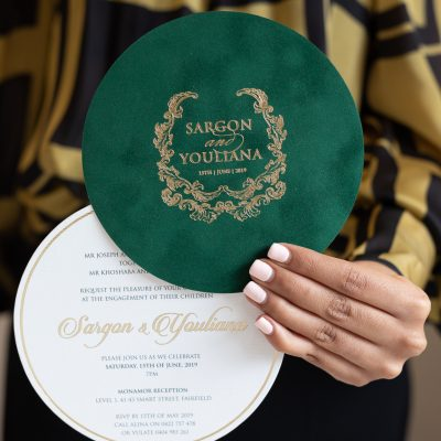Round luxury engagement invitation with green suede
