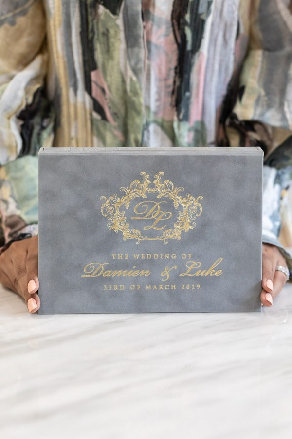 Grey suede boxed wedding invitation with a regal gold foil print