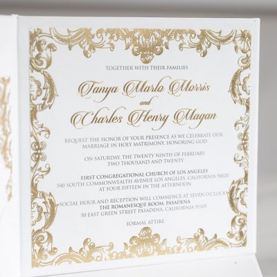 Luxury regal wedding invitation in gold with ornate border