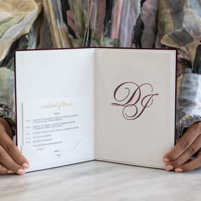 Burgundy, white and gold wedding invitation with a pocket fold