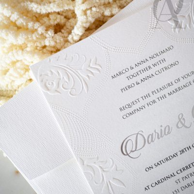 Embossed invitations with silver foil