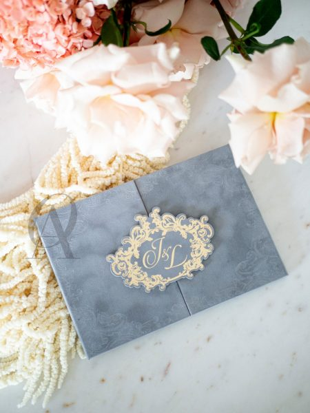 Trifold wedding invitation with grey suede hardcover and gold foil
