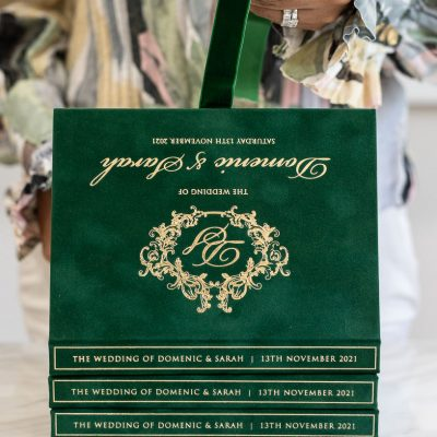 Green suede boxed wedding invitation with gold foil