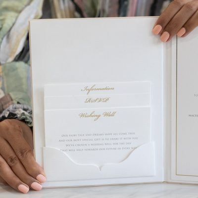 Gold and ivory wedding invitation book with a pocket fold