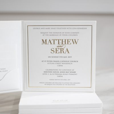 Modern and simple wedding invitations embossed in gold