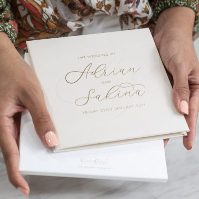 Nude wedding invitations with modern calligraphy in gold foil