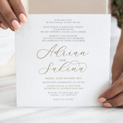 Modern calligraphy wedding invitation with floral embossing