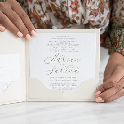 Embossed floral wedding invitation with modern calligraphy script