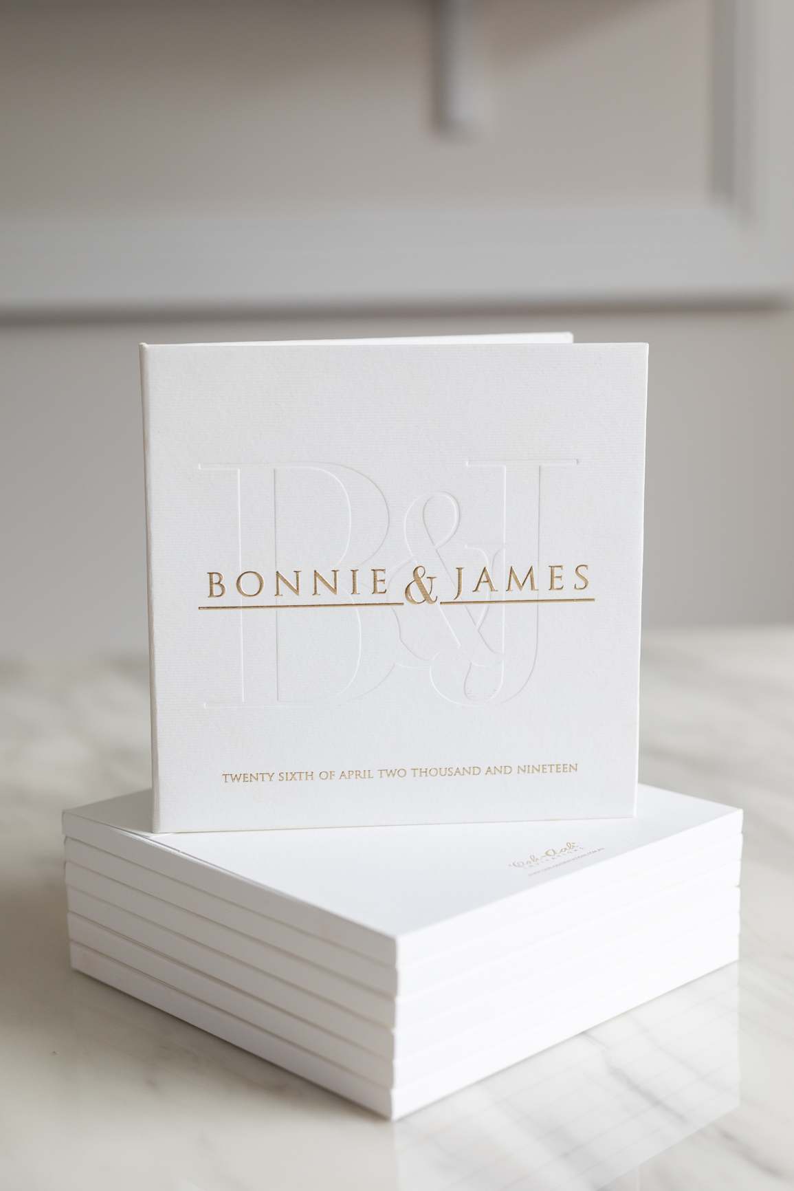 Modern letterpress invitation on hardcover booklet