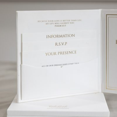 White and gold pocket fold wedding invitation with insert cards