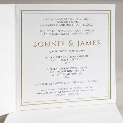 Modern white and gold wedding invitation