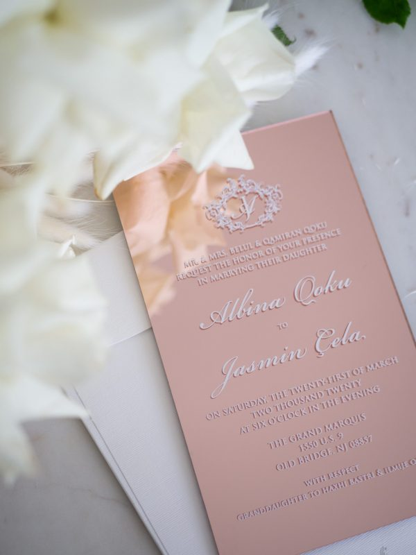 Rose gold acrylic wedding invitations with white ink print