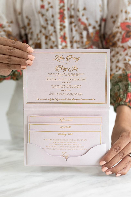 Blush pink wedding invitation with rose gold foil and pocket fold