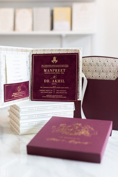 Burgundy and gold wedding invitation for royal and regal Indian wedding